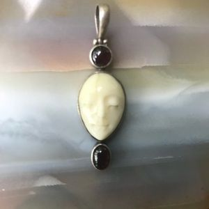 Moon face Sterling silver pendant w/Garnet stones.